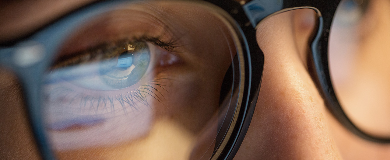 close up of woman's eyes wearing glasses